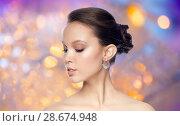 Купить «close up of beautiful woman face with earring», фото № 28674948, снято 9 апреля 2016 г. (c) Syda Productions / Фотобанк Лори