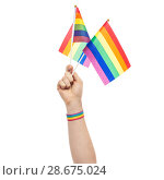 Купить «hand with gay pride rainbow flags and wristband», фото № 28675024, снято 2 ноября 2017 г. (c) Syda Productions / Фотобанк Лори