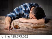 Купить «drunk man with glass of alcohol on table at night», фото № 28675052, снято 24 ноября 2017 г. (c) Syda Productions / Фотобанк Лори