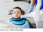 Купить «dentist making x-ray of kid teeth at dental clinic», фото № 28675092, снято 22 апреля 2018 г. (c) Syda Productions / Фотобанк Лори