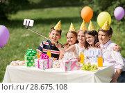 Купить «happy kids taking selfie on birthday party», фото № 28675108, снято 27 мая 2018 г. (c) Syda Productions / Фотобанк Лори