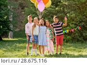 Купить «happy kids with balloons at summer birthday party», фото № 28675116, снято 27 мая 2018 г. (c) Syda Productions / Фотобанк Лори