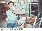 Купить «Woman customer choosing chair before buying», фото № 28675948, снято 22 ноября 2017 г. (c) Яков Филимонов / Фотобанк Лори