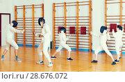 Купить «Young fencers training with coach», фото № 28676072, снято 30 мая 2018 г. (c) Яков Филимонов / Фотобанк Лори