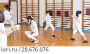 Купить «athletes practicing rapier blows in pairs», фото № 28676076, снято 30 мая 2018 г. (c) Яков Филимонов / Фотобанк Лори