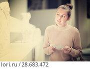 Купить «Young woman with guide-book looking at sculptures», фото № 28683472, снято 18 ноября 2017 г. (c) Яков Филимонов / Фотобанк Лори