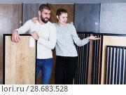Купить «couple looking laminated flooring», фото № 28683528, снято 2 февраля 2018 г. (c) Яков Филимонов / Фотобанк Лори