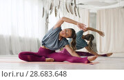 Купить «woman doing yoga exercise at studio», видеоролик № 28683648, снято 28 июня 2018 г. (c) Syda Productions / Фотобанк Лори