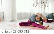 Купить «woman doing yoga exercise at studio», видеоролик № 28683712, снято 28 июня 2018 г. (c) Syda Productions / Фотобанк Лори