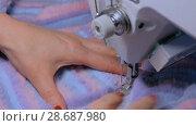 Купить «Tailor sewing fur coat with sewing machine», видеоролик № 28687980, снято 12 апреля 2018 г. (c) Aleksey Popov / Фотобанк Лори