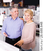 Купить «Smiling Husband and wife in store to discuss items», фото № 28688848, снято 27 марта 2019 г. (c) Яков Филимонов / Фотобанк Лори