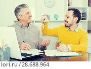 Купить «Mature man and agent sign rental agreement», фото № 28688964, снято 16 июля 2018 г. (c) Яков Филимонов / Фотобанк Лори