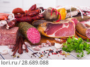 Купить «Variety of meats on table», фото № 28689088, снято 18 октября 2018 г. (c) Яков Филимонов / Фотобанк Лори