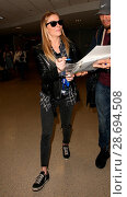 Купить «LeAnn Rimes arrives at Los Angeles International Airport her husband Eddie Cibrian and his kids Featuring: LeAnn Rimes Where: Los Angeles, California, United States When: 19 Dec 2016 Credit: WENN.com», фото № 28694508, снято 19 декабря 2016 г. (c) age Fotostock / Фотобанк Лори