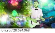 Купить «Musician man playing guitar with geometric party lights venue atmosphere», фото № 28694968, снято 16 июля 2020 г. (c) Wavebreak Media / Фотобанк Лори