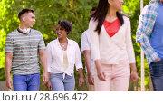 Купить «happy international friends walking in summer park», видеоролик № 28696472, снято 25 июня 2018 г. (c) Syda Productions / Фотобанк Лори
