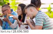 Купить «friends eating pizza, sandwich or burger in park», видеоролик № 28696560, снято 25 июня 2018 г. (c) Syda Productions / Фотобанк Лори