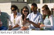 Купить «friends taking picture by selfie stick in city», видеоролик № 28696592, снято 25 июня 2018 г. (c) Syda Productions / Фотобанк Лори
