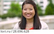 Купить «portrait of happy smiling asian woman outdoors», видеоролик № 28696628, снято 25 июня 2018 г. (c) Syda Productions / Фотобанк Лори
