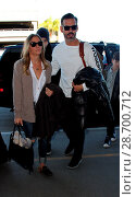 Купить «LeAnn Rimes and her husband Eddie Cibrian at Los Angeles International Airport (LAX) Featuring: LeAnn Rimes, Eddie Cibrian Where: Los Angeles, California...», фото № 28700712, снято 28 декабря 2016 г. (c) age Fotostock / Фотобанк Лори