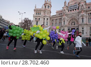 Купить «Thousands of people compete in the San Silvestre Vallecana race in Madrid, Spain on New Year's Day. More than 40,000 people ran 10 km to give their farewell...», фото № 28702460, снято 1 января 2017 г. (c) age Fotostock / Фотобанк Лори