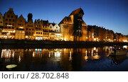 Купить «Picturesque Motlawa river embankment in old Polish town of Gdansk in twilight», видеоролик № 28702848, снято 12 мая 2018 г. (c) Яков Филимонов / Фотобанк Лори