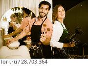 Купить «woman hairdresser and man makeup artist», фото № 28703364, снято 21 июля 2018 г. (c) Яков Филимонов / Фотобанк Лори