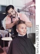 Купить «Smiling male hairdresser making hairstyle for woman», фото № 28703372, снято 11 августа 2017 г. (c) Яков Филимонов / Фотобанк Лори