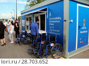 Купить «Инвалидные коляски стоят около Центра обеспечения мобильности в парке перед стадионом Самара Арена», фото № 28703652, снято 7 июля 2018 г. (c) Светлана Кириллова / Фотобанк Лори