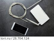 Купить «Internet cable with connector rj45, router to use wireless network and smartphone, on gray», фото № 28704124, снято 25 января 2018 г. (c) Сергей Молодиков / Фотобанк Лори