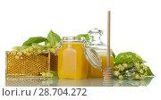 Two pots with honey, wooden spoon and honeycomb isolated on white. Стоковое фото, фотограф Сергей Молодиков / Фотобанк Лори