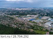 Купить «Aerial view of wheat fields, meadow, forest andindustrial warehouses in rural Russia.», фото № 28704292, снято 11 июня 2018 г. (c) Андрей Радченко / Фотобанк Лори