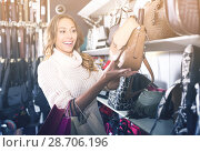 Купить «Excited young female shopping new handbag», фото № 28706196, снято 19 января 2019 г. (c) Яков Филимонов / Фотобанк Лори