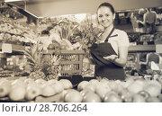 Купить «saleswoman with variety of vegetables and fruits», фото № 28706264, снято 14 октября 2017 г. (c) Яков Филимонов / Фотобанк Лори