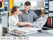 Купить «couple searching samples of wallpaper at magazine», фото № 28706472, снято 17 мая 2018 г. (c) Яков Филимонов / Фотобанк Лори