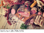 Купить «Variety of meats on table», фото № 28706516, снято 18 октября 2018 г. (c) Яков Филимонов / Фотобанк Лори