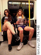 Купить «Over 100 people take part in the annual 'No Trousers Tube Ride' event on the London Underground only hours before a 24-hour strike action starts on the...», фото № 28714148, снято 8 января 2017 г. (c) age Fotostock / Фотобанк Лори