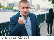Купить «Angry businessman threaten with a fist», фото № 28723208, снято 13 июня 2018 г. (c) Александр Лычагин / Фотобанк Лори