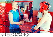 Купить «Sportsman at boxing workout with coach at gym», фото № 28723440, снято 12 апреля 2017 г. (c) Яков Филимонов / Фотобанк Лори