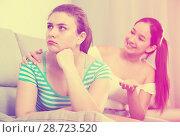 Купить «Girl asking for forgiveness from friend on sofa», фото № 28723520, снято 7 июня 2017 г. (c) Яков Филимонов / Фотобанк Лори