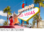 Купить «friends driving in convertible car at las vegas», фото № 28723808, снято 28 мая 2016 г. (c) Syda Productions / Фотобанк Лори