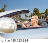Купить «woman recording voice on smartphone at car», фото № 28723824, снято 17 августа 2017 г. (c) Syda Productions / Фотобанк Лори