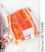 Купить «salmon fish fillet on ice at grocery», фото № 28723840, снято 2 ноября 2016 г. (c) Syda Productions / Фотобанк Лори