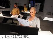 Купить «designer working with papers at night office», фото № 28723892, снято 26 ноября 2017 г. (c) Syda Productions / Фотобанк Лори
