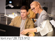 Купить «business team with computer working late at office», фото № 28723912, снято 26 ноября 2017 г. (c) Syda Productions / Фотобанк Лори