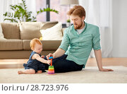 Купить «father playing with little baby daughter at home», фото № 28723976, снято 26 апреля 2018 г. (c) Syda Productions / Фотобанк Лори