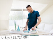 Купить «man ironing shirt by iron at home», фото № 28724004, снято 10 мая 2018 г. (c) Syda Productions / Фотобанк Лори