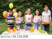 Купить «happy kids with gifts on birthday party at summer», фото № 28724008, снято 27 мая 2018 г. (c) Syda Productions / Фотобанк Лори