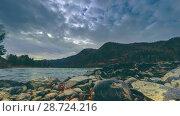 Купить «Time lapse shot of a river near mountain forest. Huge rocks and fast clouds movenings. Horizontal slider movement», видеоролик № 28724216, снято 16 марта 2018 г. (c) Александр Маркин / Фотобанк Лори