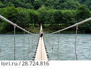 Купить «Абхазия. Подвесной мост через реку Бзыбь летним днём», эксклюзивное фото № 28724816, снято 5 июня 2018 г. (c) Игорь Низов / Фотобанк Лори